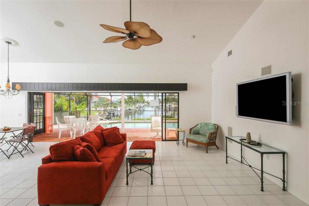 The pocketing sliders open to the spacious covered lanai and pool - Single Family Home for sale at 1620 Appian Dr, Punta Gorda, FL 33950 - MLS Number is C7242315