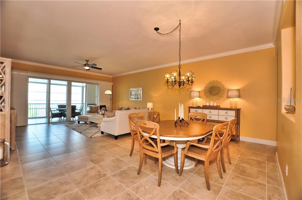 Dining and Great Room view overlooking lanai and Charlotte Harbor - Condo for sale at 95 N Marion Ct #136, Punta Gorda, FL 33950 - MLS Number is C7243837