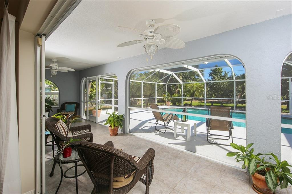 Tile lanai that overlooks the pool - this is wonderful outdoor living space - Single Family Home for sale at 4407 Albacore Cir, Port Charlotte, FL 33948 - MLS Number is C7245070