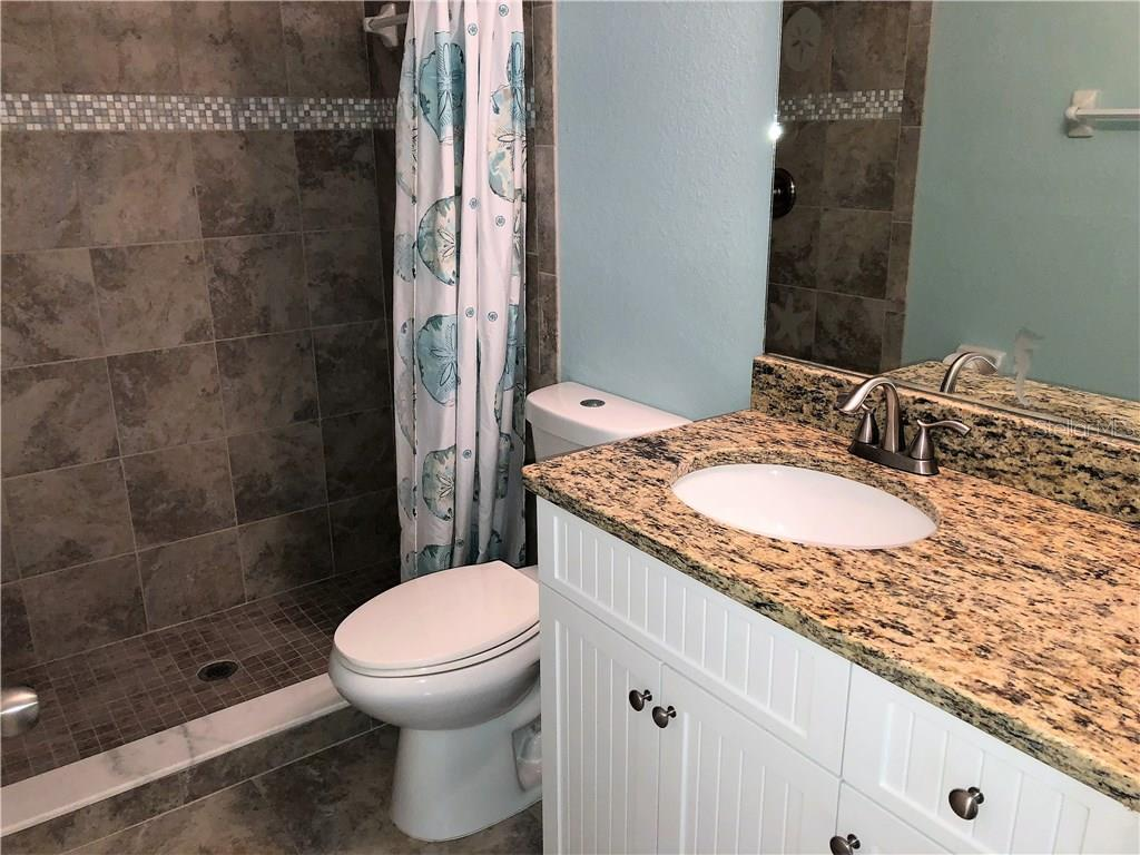 Second bedroom.  Each bedroom has a ceiling fan. - Single Family Home for sale at 191 Broadmoor Ln, Rotonda West, FL 33947 - MLS Number is C7250730
