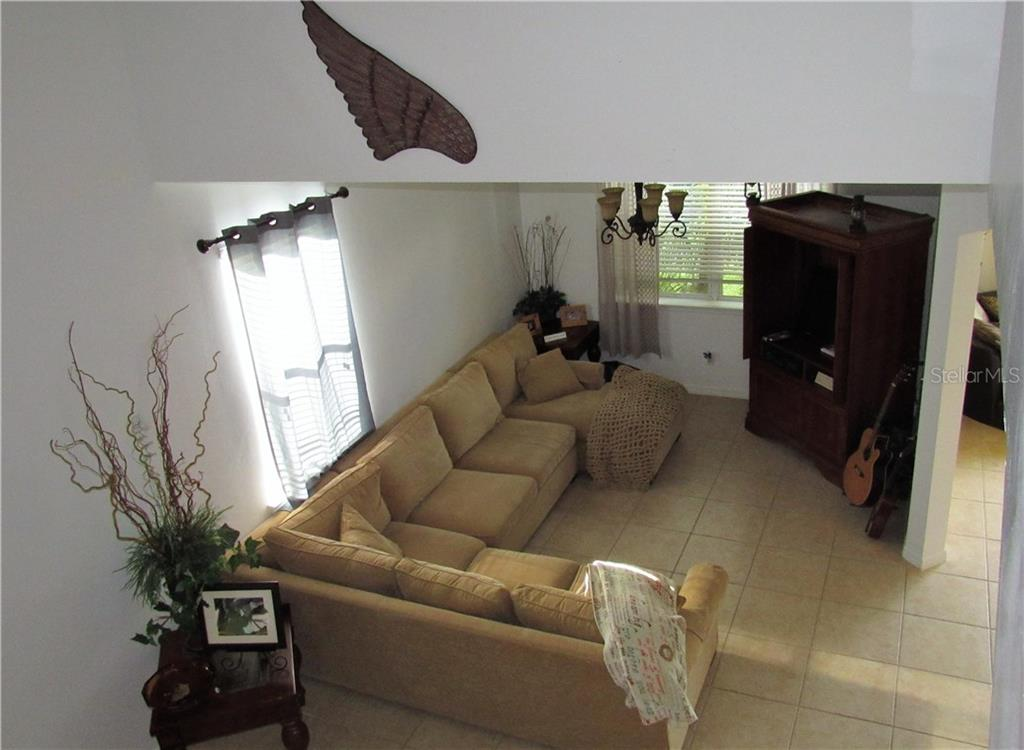 View of the living room from the staircase. - Single Family Home for sale at 24041 Canal St, Port Charlotte, FL 33980 - MLS Number is C7400879