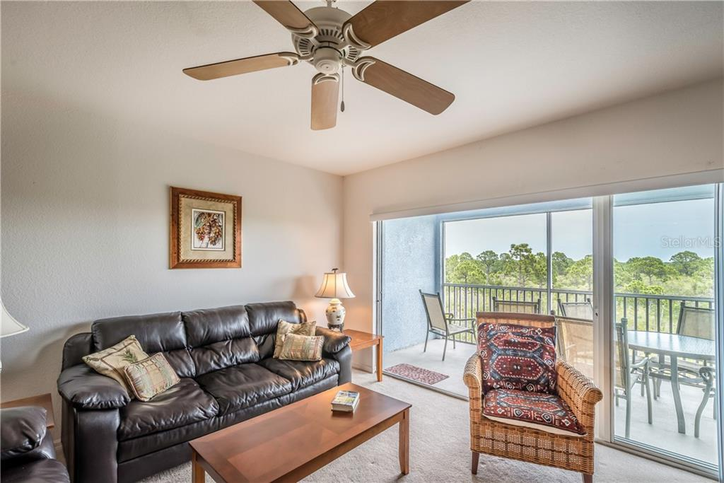 Living area with view of lanai and nature preserve. - Condo for sale at 8413 Placida Rd #403, Placida, FL 33946 - MLS Number is C7401304
