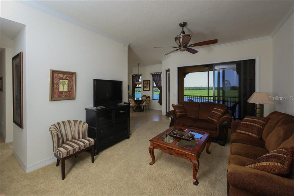 Great room - this condo is being sold turnkey furnished - Condo for sale at 95 Vivante Blvd #303, Punta Gorda, FL 33950 - MLS Number is C7402746