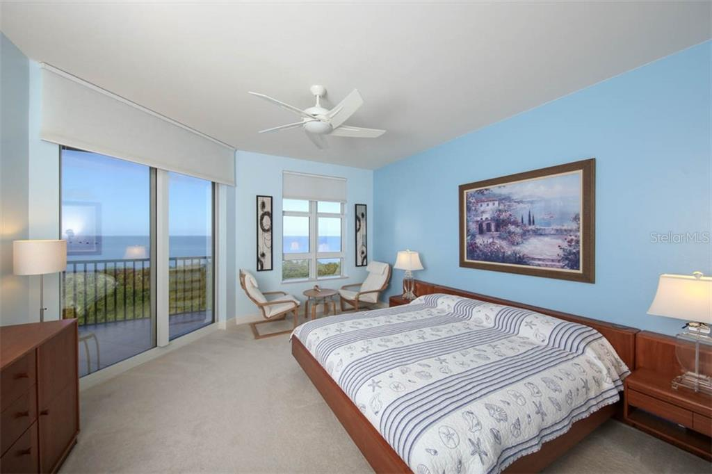 Master suite enjoys a wall of impact glass affording spectacular views to wake up to each and every day.  There is a large walk-in closet along with spacious linen closet that leads to the private bath. - Condo for sale at 3329 Sunset Key Cir #503, Punta Gorda, FL 33955 - MLS Number is C7406727