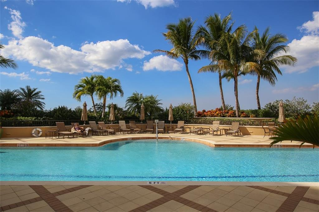 Elevated tropical sundeck features geo thermal heated pool and a variety of chairs, chaises and patio tables for the exclusive use of Grande Isle III & IV owners and their guests. - Condo for sale at 3329 Sunset Key Cir #503, Punta Gorda, FL 33955 - MLS Number is C7406727
