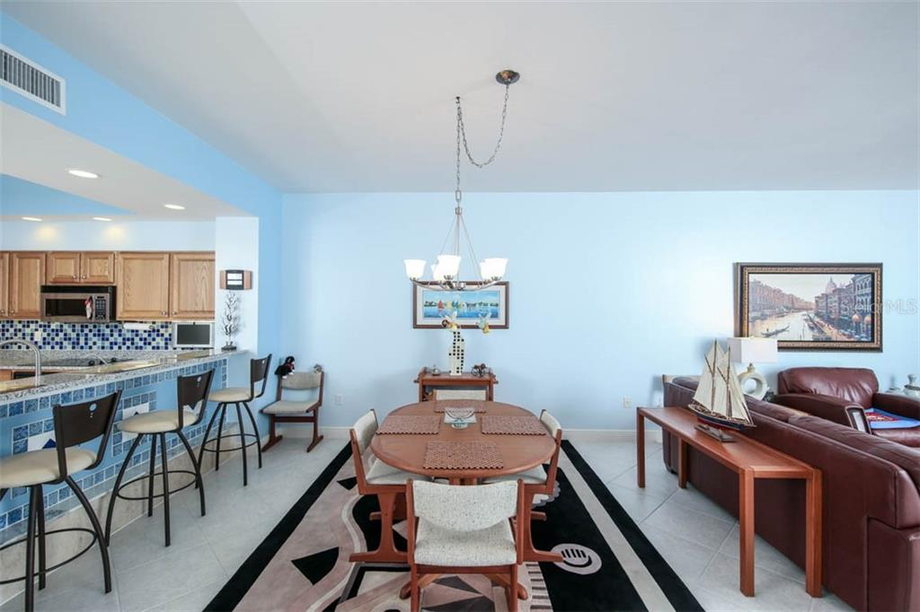 Dining area is situated between the kitchen and great room and takes full advantage of the views that can be appreciated in all 3 spaces! - Condo for sale at 3329 Sunset Key Cir #503, Punta Gorda, FL 33955 - MLS Number is C7406727