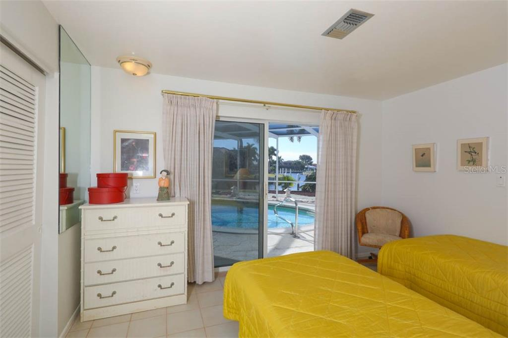 Bedroom 2 pool side - Single Family Home for sale at 2291 Bayview Rd, Punta Gorda, FL 33950 - MLS Number is C7409445