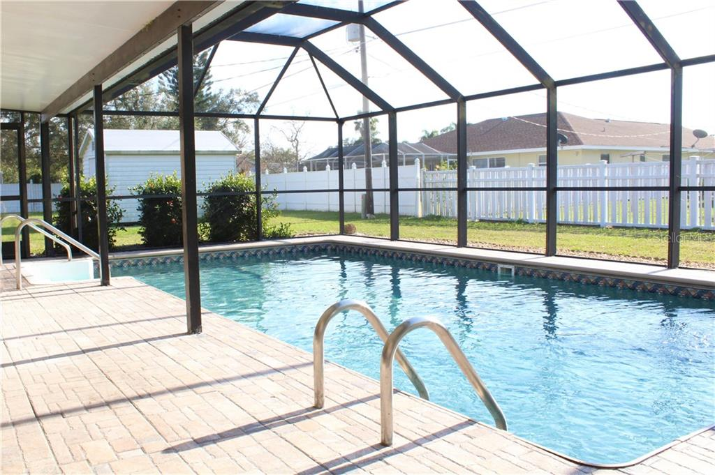 Pool has recently replaced vinyl liner and new tile with paver look - Single Family Home for sale at 2307 Lake View Blvd, Port Charlotte, FL 33948 - MLS Number is C7410319