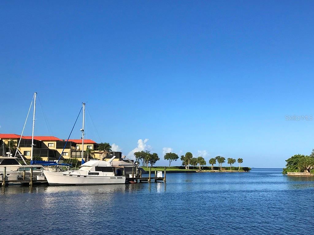 Looking out the channel from the south basin to Charlotte Harbor. A boater's dream. Only 10 nautical miles to Boca Grande Pass and the Gulf of Mexico. - Condo for sale at 3461 Sunset Key Cir #102, Punta Gorda, FL 33955 - MLS Number is C7413196
