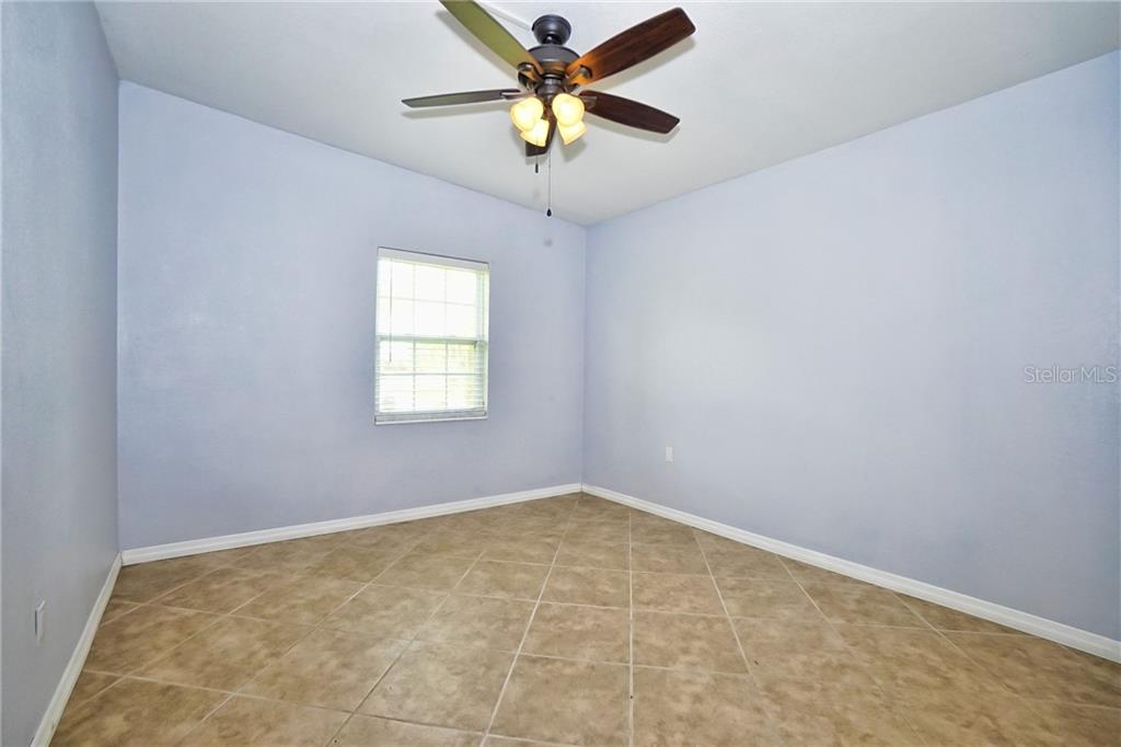 Bedroom 2 - Ceiling Fan - Single Family Home for sale at 3513 Areca St, Punta Gorda, FL 33950 - MLS Number is C7414620