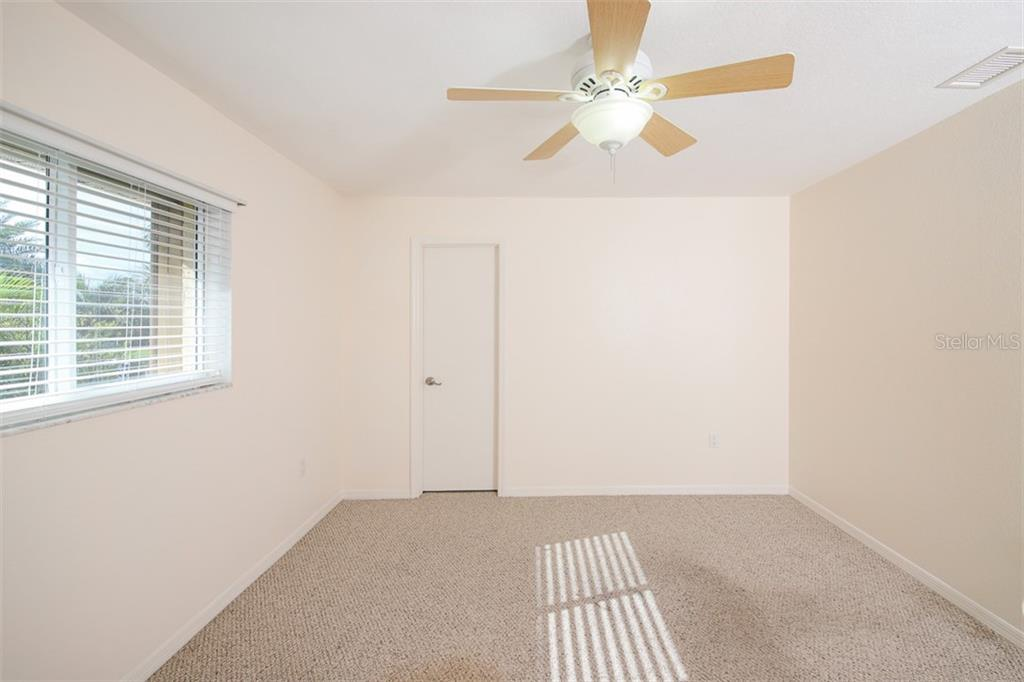 Bedroom 3 overlook pool & has walk-in closet. - Single Family Home for sale at 2713 Saint Thomas Dr, Punta Gorda, FL 33950 - MLS Number is C7417491
