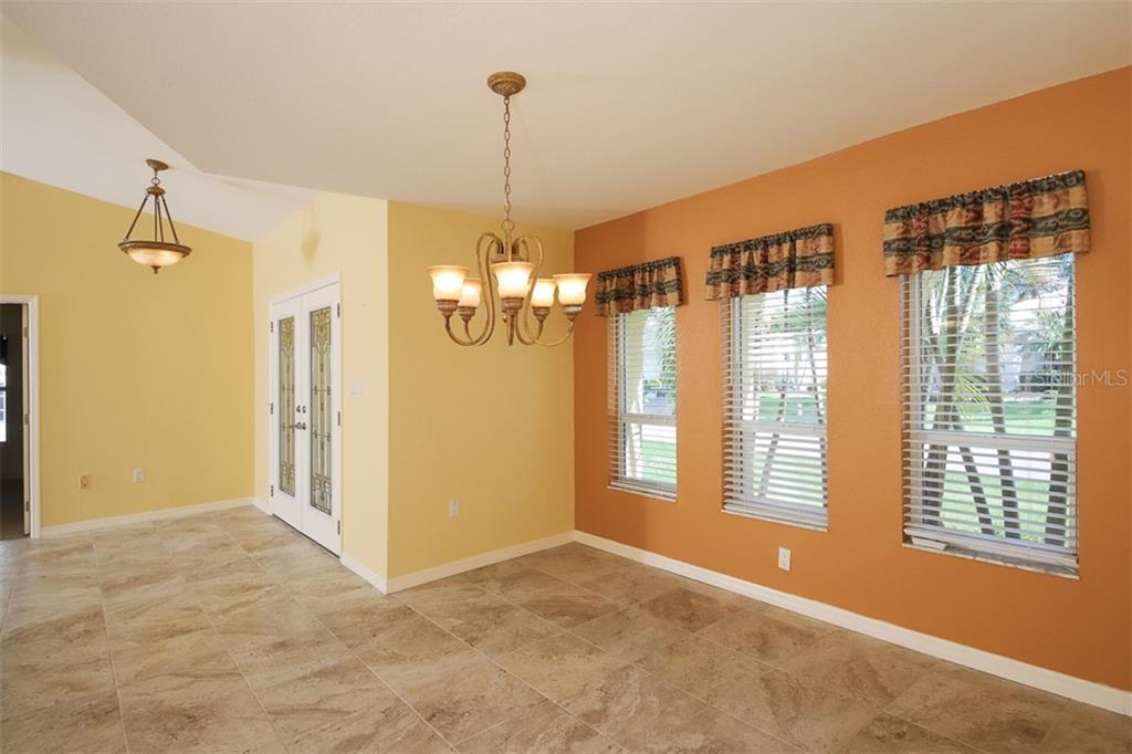 Living area with stacking slider give wide opening to Lanai & pool. - Single Family Home for sale at 2713 Saint Thomas Dr, Punta Gorda, FL 33950 - MLS Number is C7417491