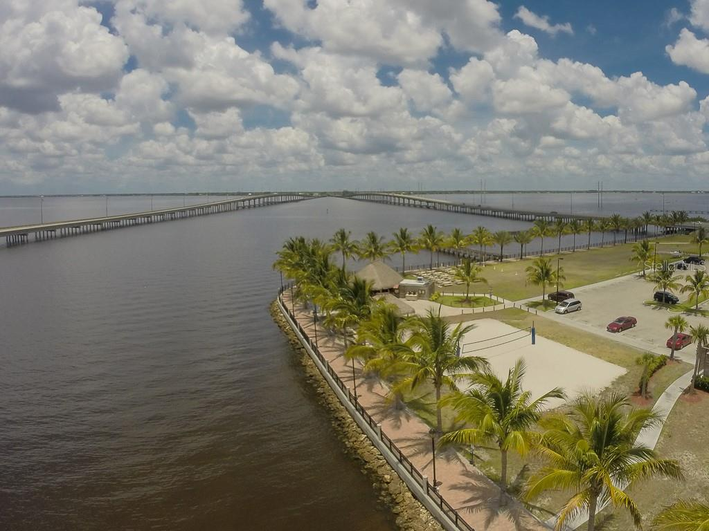 Part of the 3 miles of walking/jogging/running path that surrounds that Punta Gorda waterfront.  The Tiki Bar is one of the top spots to watch the sunset and enjoy meeting friends - Vacant Land for sale at 24166 Henry Morgan Blvd, Punta Gorda, FL 33955 - MLS Number is C7417999