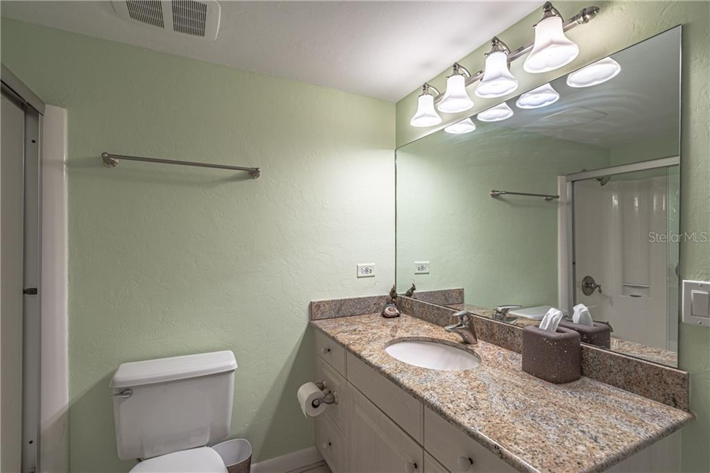Lower level Master #2 ensuite with shower/tub - Single Family Home for sale at 124 Useppa Is, Captiva, FL 33924 - MLS Number is C7419408