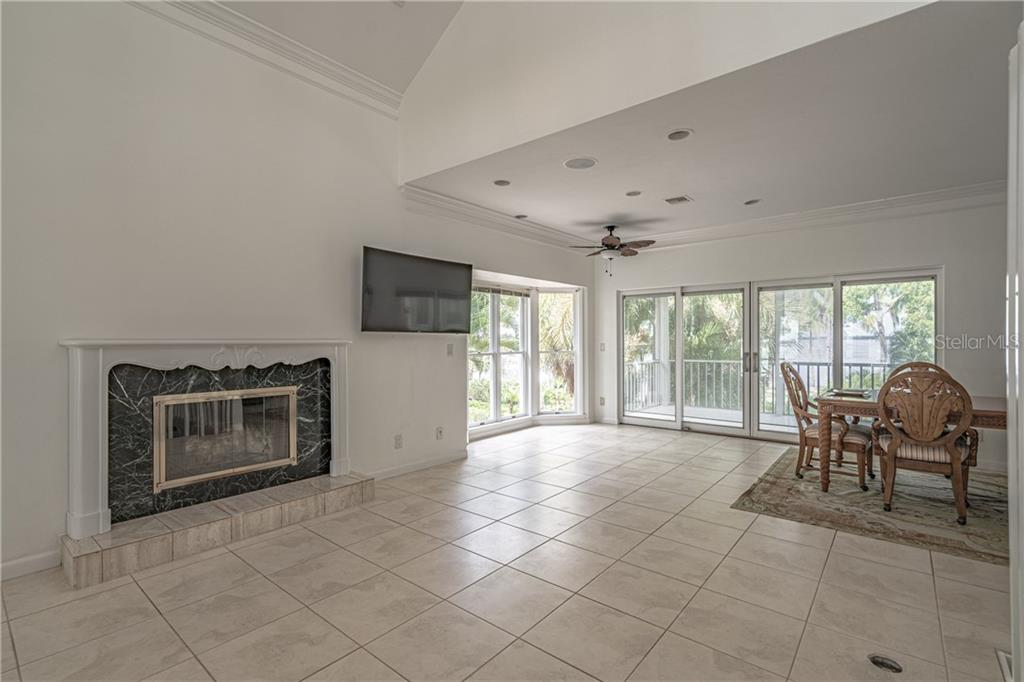 Great room fireplace, recessed in floor electric outlets - Single Family Home for sale at 124 Useppa Is, Captiva, FL 33924 - MLS Number is C7419408