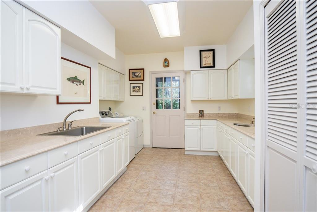 The Aquarium provides a window out to the stairwell - Single Family Home for sale at 2 Mandershaw Ln, Punta Gorda, FL 33982 - MLS Number is C7422349