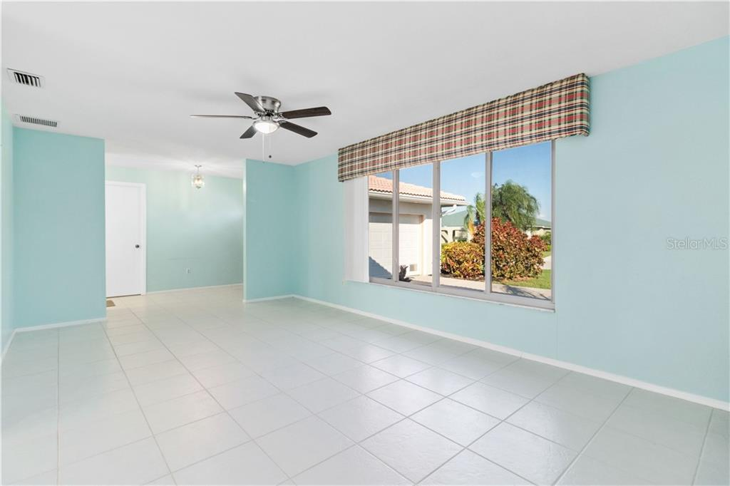 Living Room features four panel front window of impact glass. Door in Foyer goes to inside Laundry. - Single Family Home for sale at 415 Caicos Dr, Punta Gorda, FL 33950 - MLS Number is C7422767