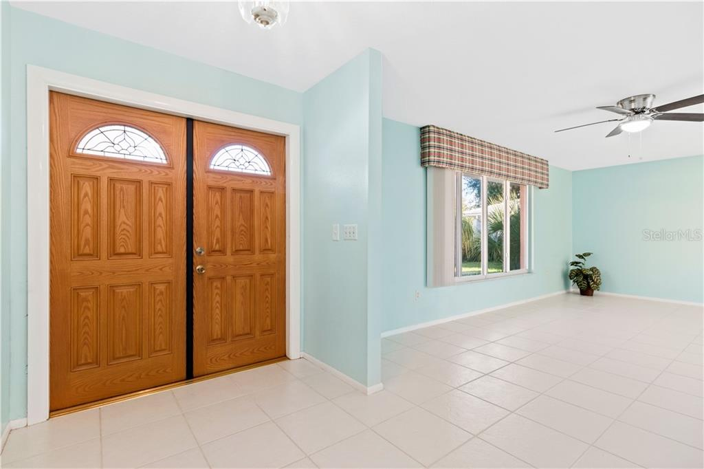 Tile runs from the entry foyer throughout the Living Areas - Single Family Home for sale at 415 Caicos Dr, Punta Gorda, FL 33950 - MLS Number is C7422767