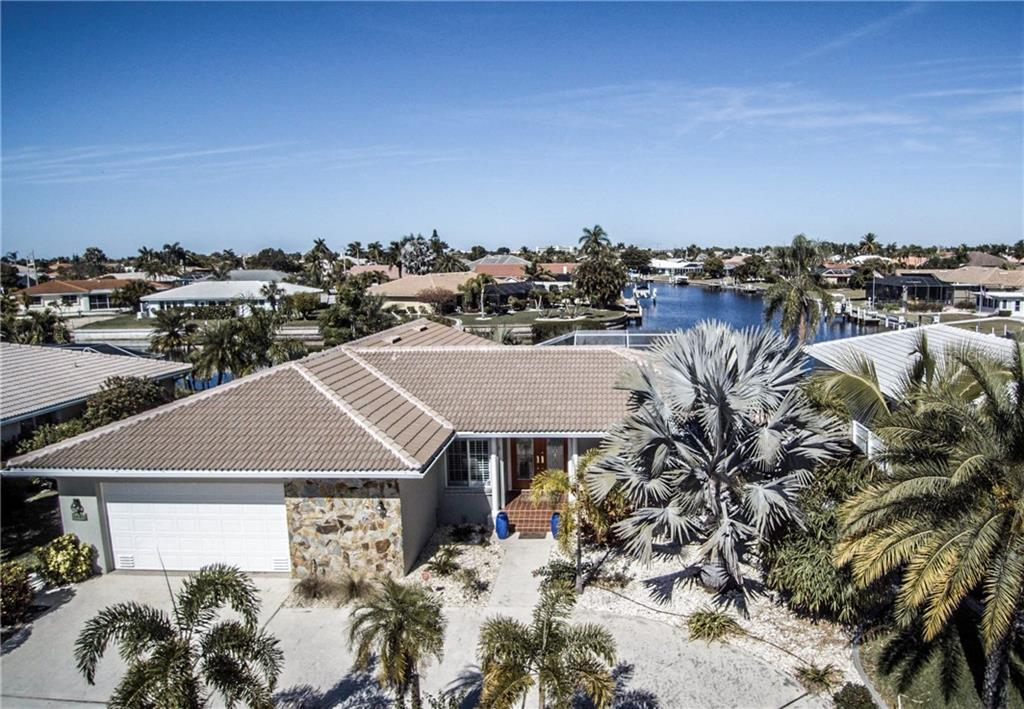 Mature tropical landscaping surrounds this home, adding extra privacy. - Single Family Home for sale at 1440 Appian Dr, Punta Gorda, FL 33950 - MLS Number is C7425399