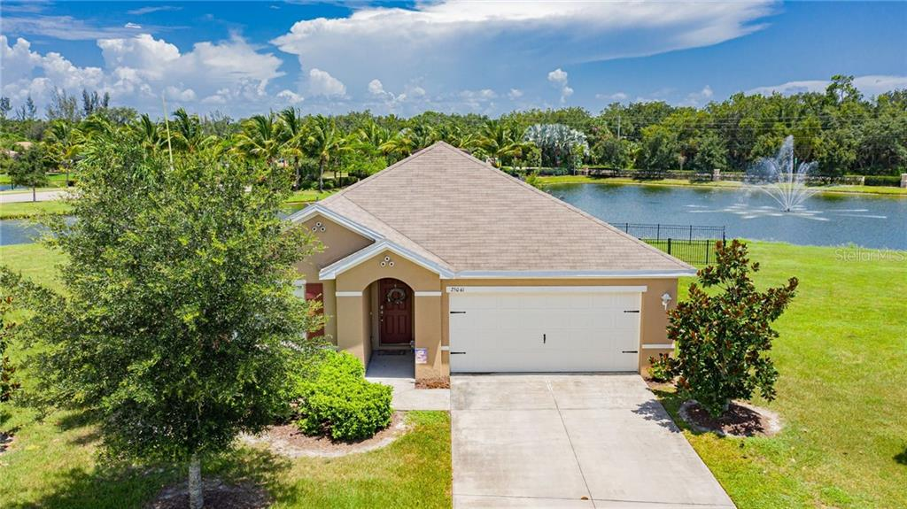 Lake's water feature fountains just part of the ambiance. - Single Family Home for sale at 25041 Lalique Pl, Punta Gorda, FL 33950 - MLS Number is C7430423