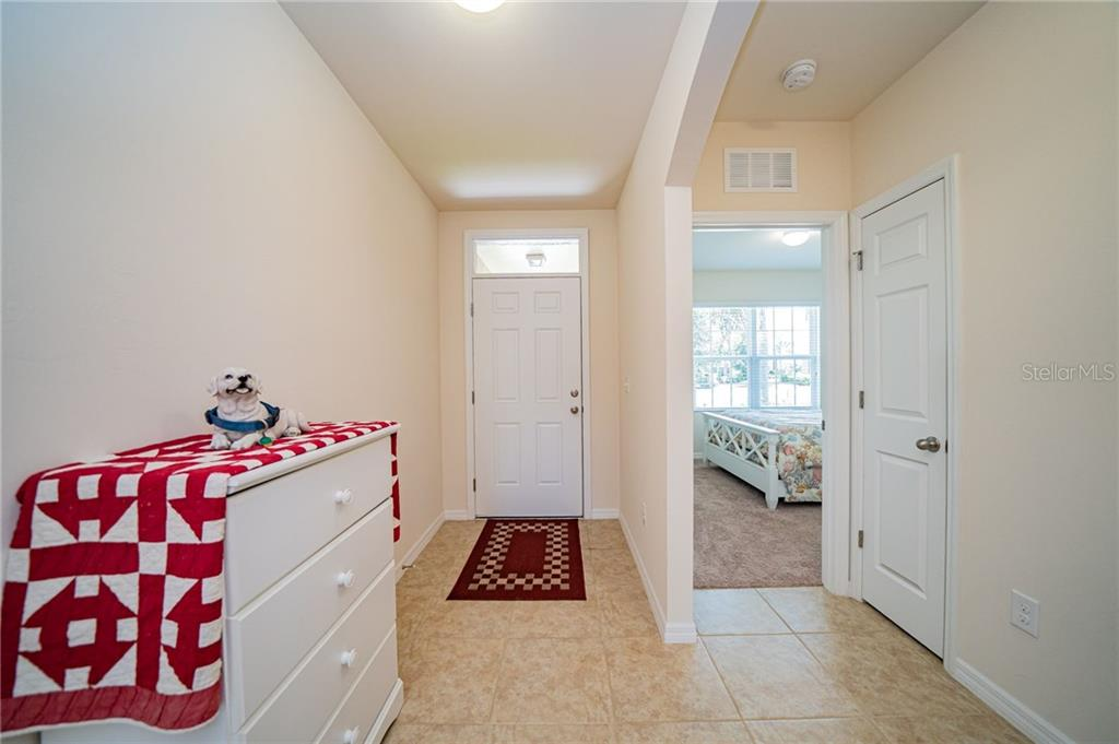 Entry foyer with Bedroom 2 at front of home. - Single Family Home for sale at 25041 Lalique Pl, Punta Gorda, FL 33950 - MLS Number is C7430423