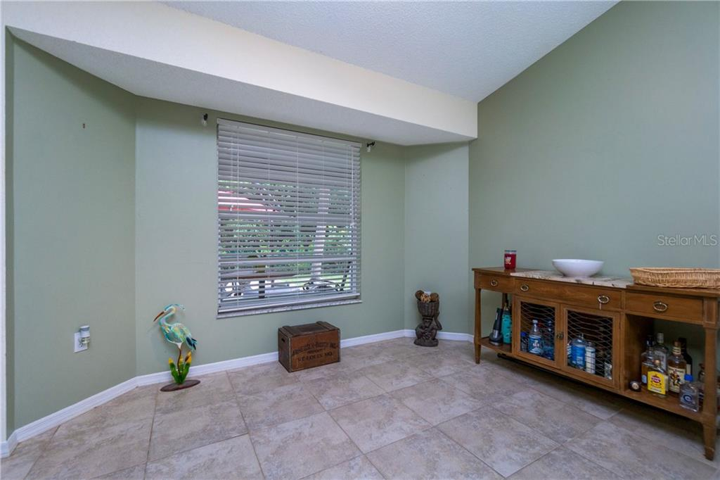 Flexible use for rear Dinette overlooking Lanai & backyard. - Single Family Home for sale at 23374 Macdougall Ave, Port Charlotte, FL 33980 - MLS Number is C7430508