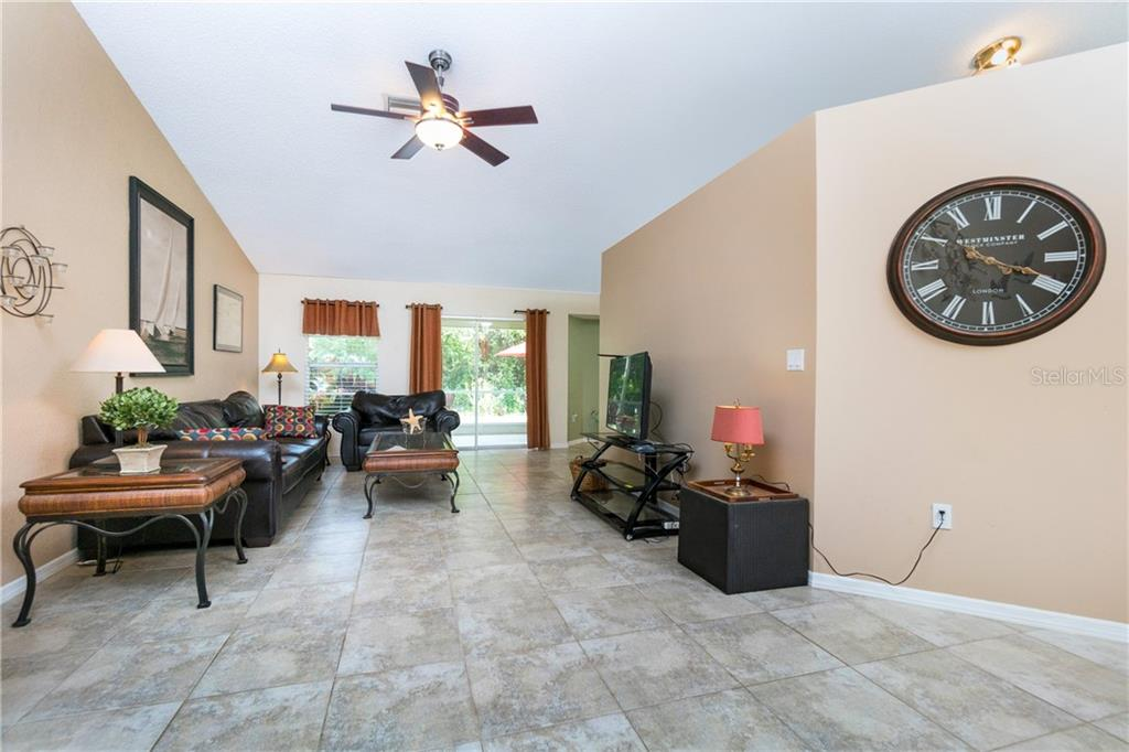 Secondary Bedrooms to left from Great Room. - Single Family Home for sale at 23374 Macdougall Ave, Port Charlotte, FL 33980 - MLS Number is C7430508
