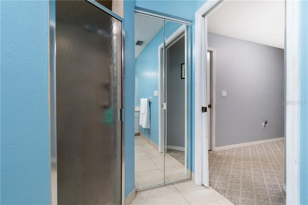 Owner Suite has walk-in closet & separate linen. - Single Family Home for sale at 23374 Macdougall Ave, Port Charlotte, FL 33980 - MLS Number is C7430508