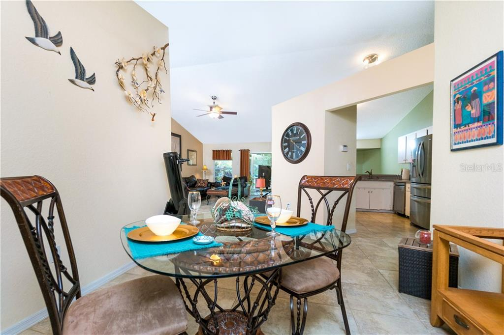 Front Dining Area off Kitchen is open to Great Room. - Single Family Home for sale at 23374 Macdougall Ave, Port Charlotte, FL 33980 - MLS Number is C7430508