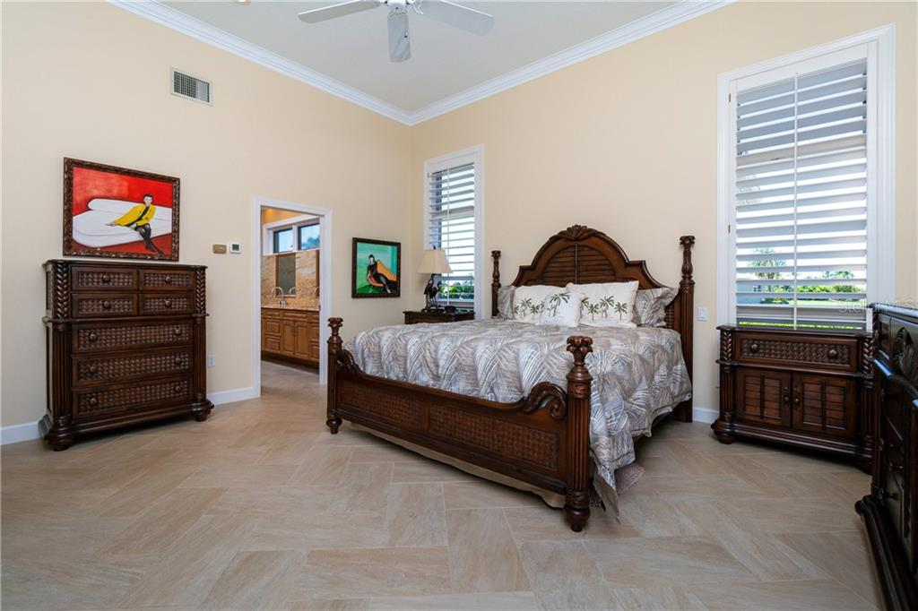 MASTER BEDROOM WITH PLANTATION SHUTTERS - Single Family Home for sale at 3537 Caya Largo Ct, Punta Gorda, FL 33950 - MLS Number is C7431664