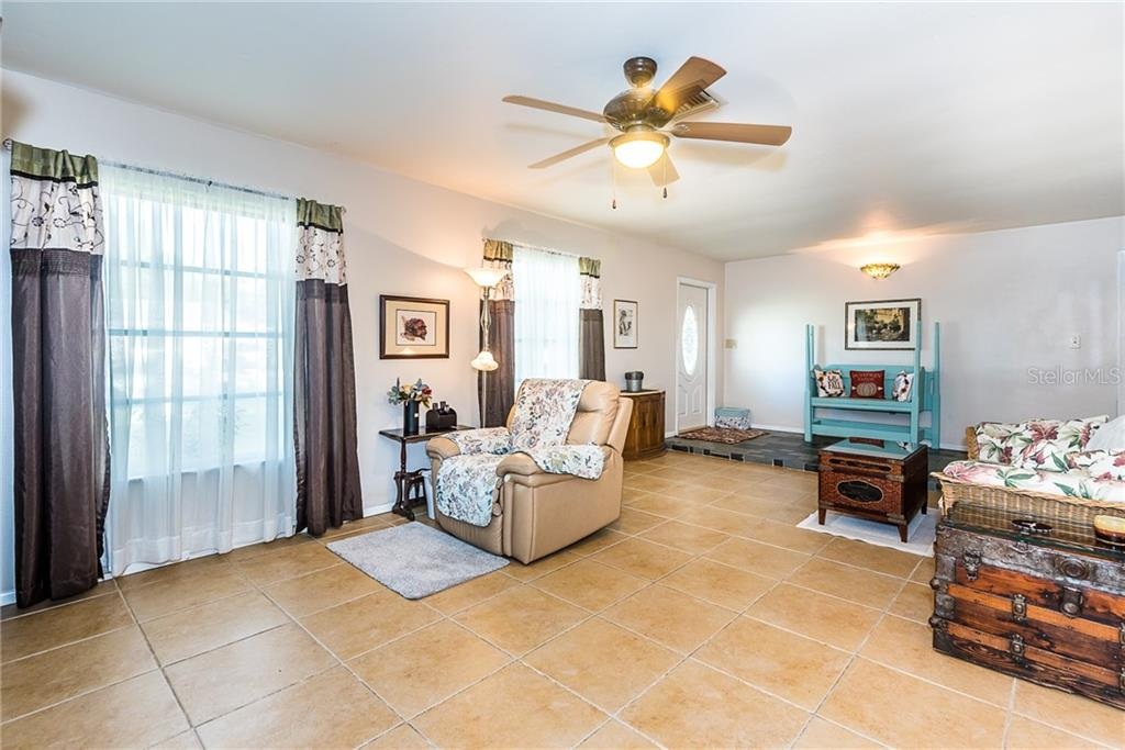 GREAT ROOM - Single Family Home for sale at 1365 Arrow St, Port Charlotte, FL 33952 - MLS Number is C7435304