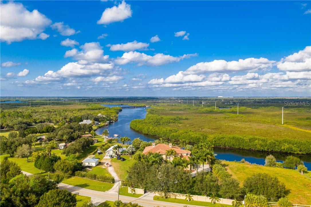 Majestically poised on Shell Creek, minutes from the Peace River and Charlotte Harbor - Single Family Home for sale at 7440 Riverside Dr, Punta Gorda, FL 33982 - MLS Number is C7436263