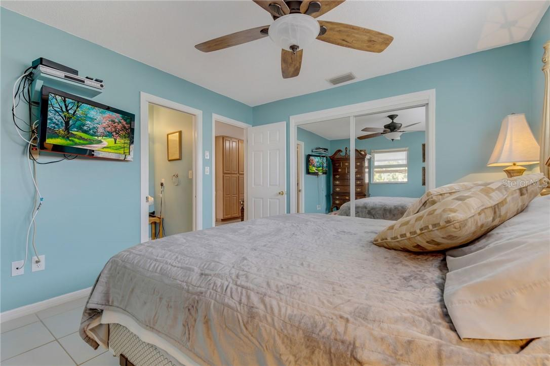 Owners suite looking to the ensuite bath. - Single Family Home for sale at 24368 Blackbeard Blvd, Punta Gorda, FL 33955 - MLS Number is C7436898