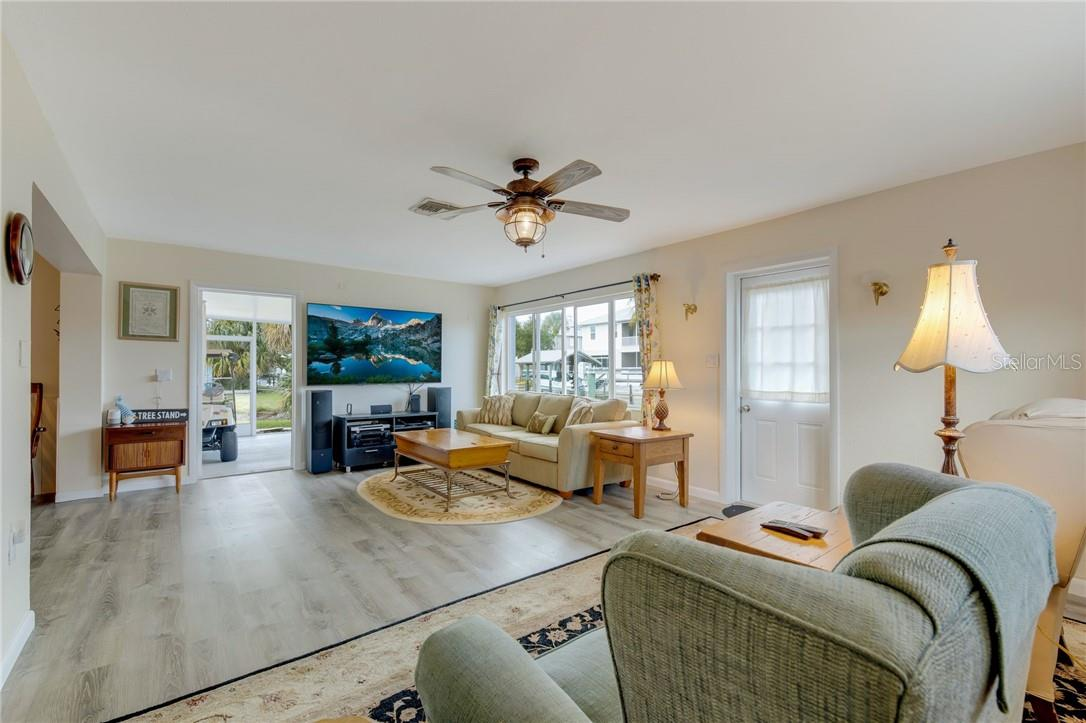 Living area looking out to the canal and oversized lanai. - Single Family Home for sale at 24368 Blackbeard Blvd, Punta Gorda, FL 33955 - MLS Number is C7436898