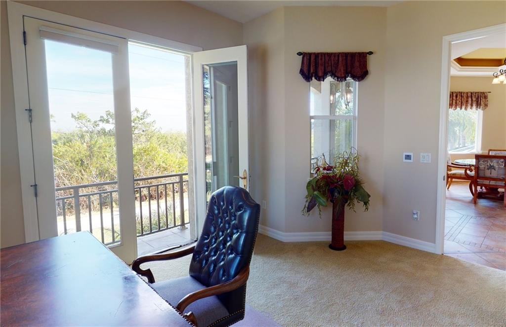 2nd floor guest bedroom with French doors to balcony. - Single Family Home for sale at 4245 Spire St, Port Charlotte, FL 33981 - MLS Number is C7437570