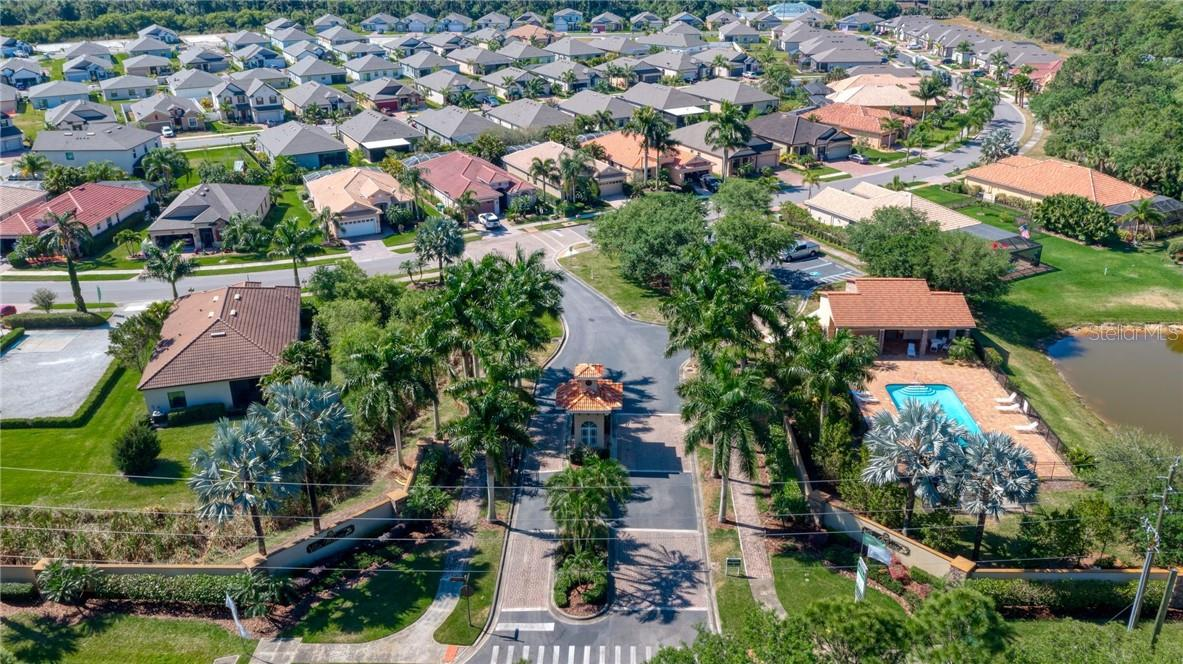 Ariel view of the entry of Villa Milano. - Single Family Home for sale at 2082 Apian Way, Port Charlotte, FL 33953 - MLS Number is C7441465