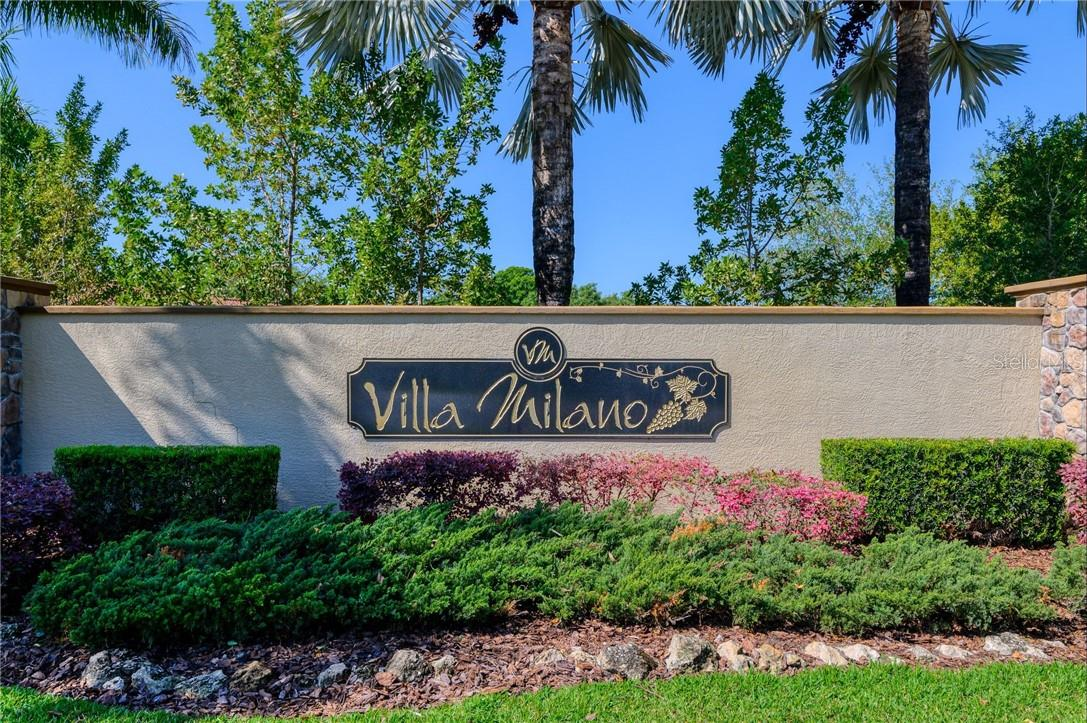 Villa Milano's entry way welcomes everyone to this wonderful gated community. - Single Family Home for sale at 2082 Apian Way, Port Charlotte, FL 33953 - MLS Number is C7441465