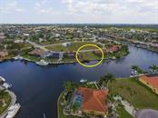 Almar canal- lot is to the right - Vacant Land for sale at 4027 Turtle Dove Cir, Punta Gorda, FL 33950 - MLS Number is C7237554