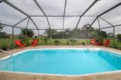 Amazing privacy with large greenbelt behind the home and areca palms that line the home behind - Single Family Home for sale at 26178 Rampart Blvd, Punta Gorda, FL 33983 - MLS Number is C7240559