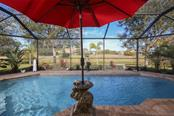 Enjoy many days and nights swimming in this stunning pool that overlooks a freshwater canal - Single Family Home for sale at 220 Broadmoor Ln, Rotonda West, FL 33947 - MLS Number is C7248036