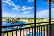 A view of the pool - Condo for sale at 1349 Aqui Esta Dr #142, Punta Gorda, FL 33950 - MLS Number is C7407779