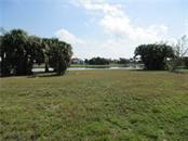 Nice level waterfront lot- a blank palette for excellence - Vacant Land for sale at 16308 Cayman Ln, Punta Gorda, FL 33955 - MLS Number is C7413152