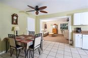 Dining Area in Eat-in Kitchen with Family Room beyond - Single Family Home for sale at 21439 Carleton Ave, Port Charlotte, FL 33952 - MLS Number is C7418016