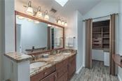 Master Bathroom with custom closet - Single Family Home for sale at 124 Useppa Is, Captiva, FL 33924 - MLS Number is C7419408