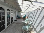 Courtyard with 50' Pergola - Single Family Home for sale at 1302 Pinebrook Way, Venice, FL 34285 - MLS Number is C7435367