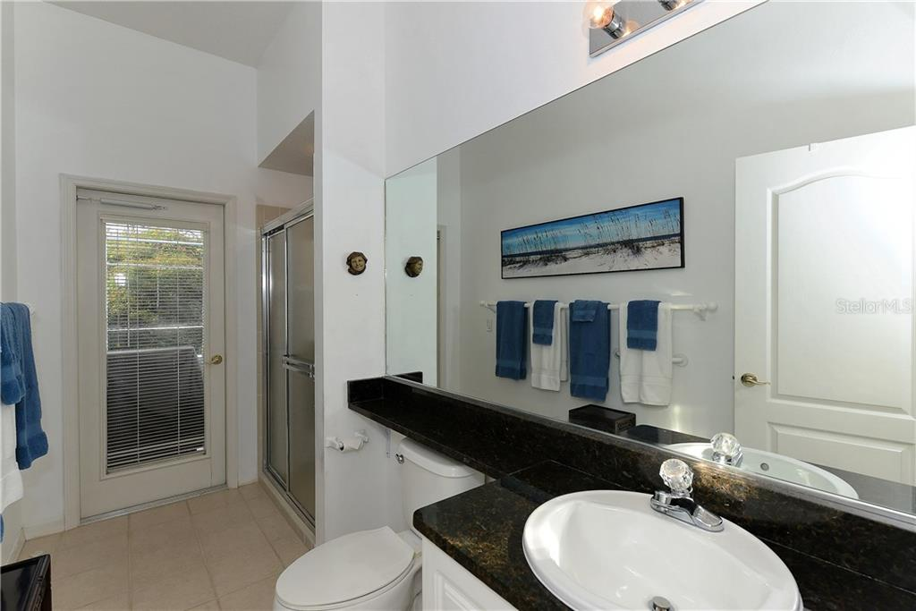 Pool bath and 4th bedroom 'en-suite' bath. - Single Family Home for sale at 8753 Merion Ave, Sarasota, FL 34238 - MLS Number is A4165409