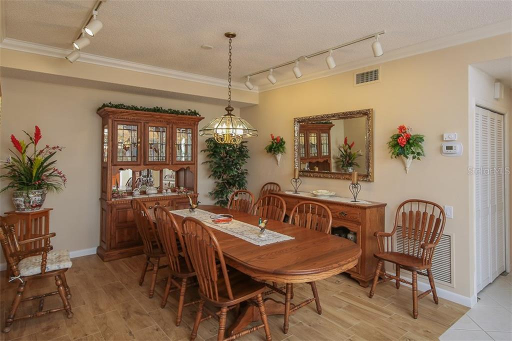 Dining area - Condo for sale at 7631 Fairway Woods Dr #601, Sarasota, FL 34238 - MLS Number is A4168292