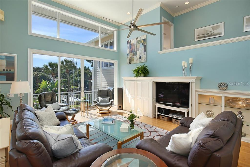 Vaulted Ceilings and an Abundance of Windows bring a flow of Florida Sunshine into the Living Room! Wrap Around Corridor above to the Master Suite! - Single Family Home for sale at 722 Siesta Dr, Sarasota, FL 34242 - MLS Number is A4169257