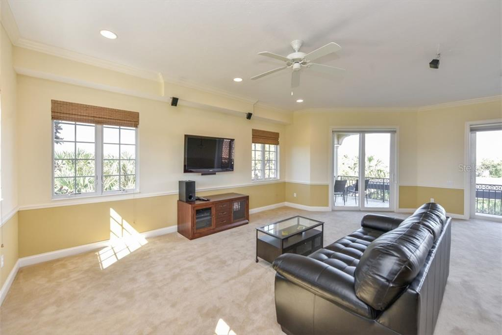 Large bonus room has views of the golf course, covered deck on two sides, kitchen/bar area and full bedroom with ensuite bath. - Single Family Home for sale at 3313 Founders Club Dr, Sarasota, FL 34240 - MLS Number is A4169443