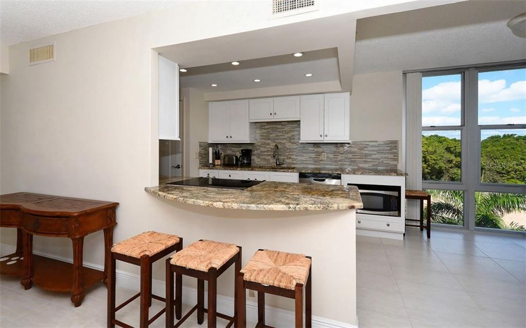 Breakfast bar and Kitchen - Condo for sale at 1701 Gulf Of Mexico Dr #505, Longboat Key, FL 34228 - MLS Number is A4170632